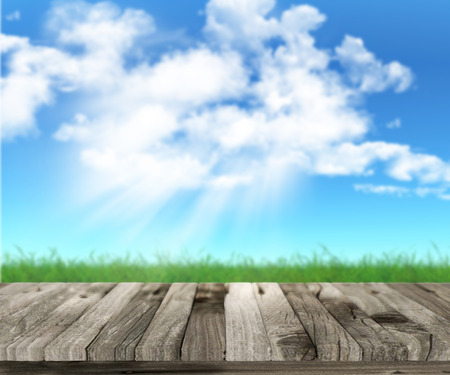 defocussed: 3D wooden table with defocussed grassy landscape in the background Stock Photo