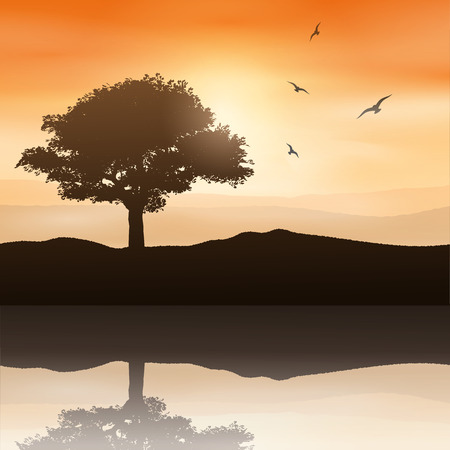 reflected: Silhouette of a tree against a sunset sky reflected in water Stock Photo