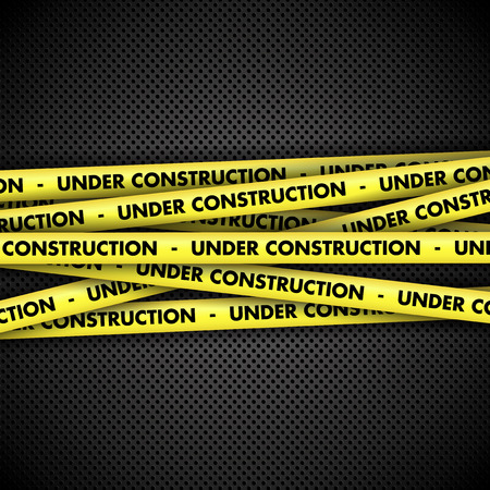 Under construction warning tape on perforated metal background 版權商用圖片