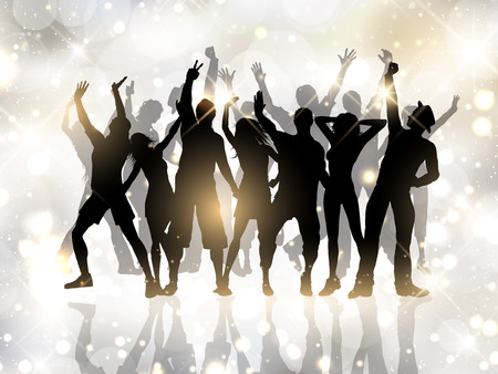 Silhouettes of people dancing on a bokeh lights