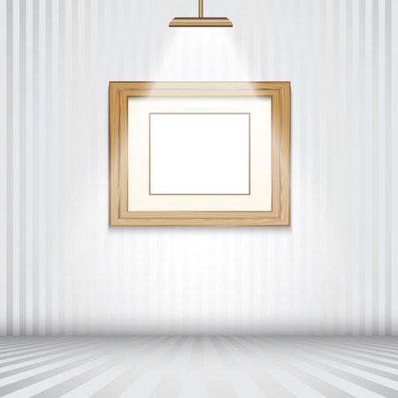 empty frame: Spotlit room with empty wooden picture frame