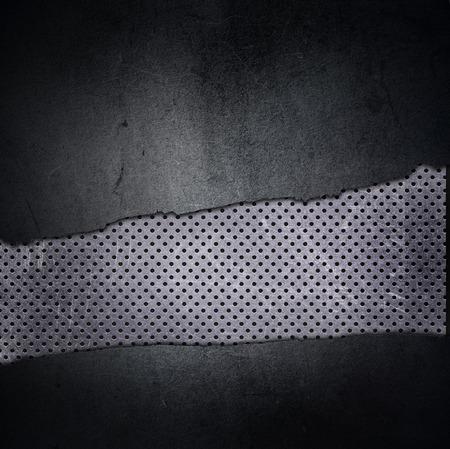 Grunge textuur achtergrond met gebarsten beton en geperforeerd metaal