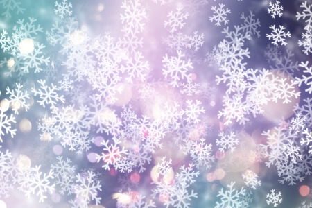Decorative Christmas background with snowflakes and bokeh lights