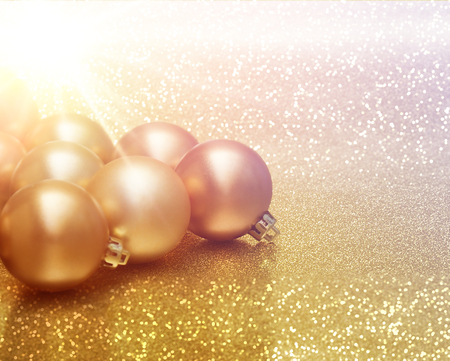 glittery: Christmas baubles on glittery gold background