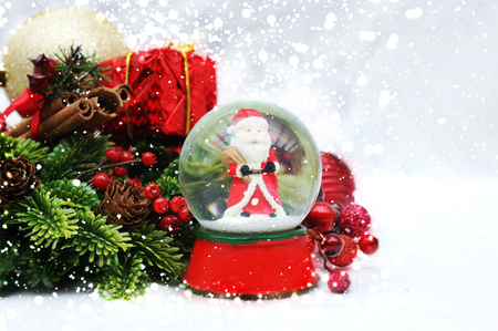 holiday lights display: Christmas background with Santa Claus in a snow globe