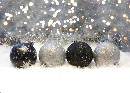 silver and black christmas decorations nestled in snow stock photo 47499926 - Black And Silver Christmas Decorations