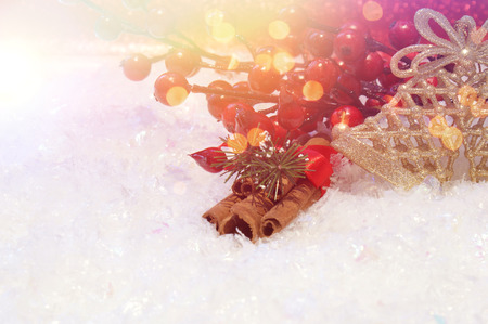nestled: Christmas decorations nestled in snow with retro effect