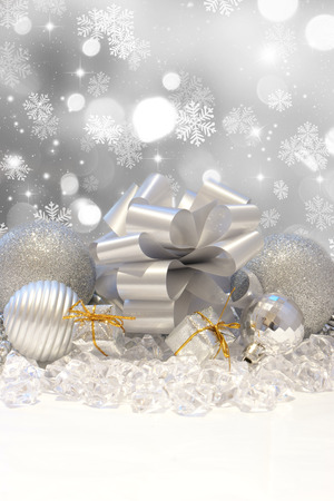 christmas decorations: Silver Christmas decorations on a snowflake background Stock Photo