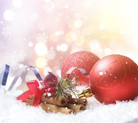 nestled: Christmas background with decorations nestled in snow Stock Photo