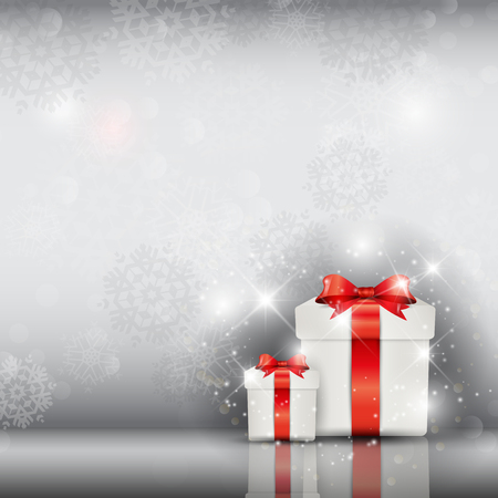 Christmas gifts on a silver snowflake background Stockfoto