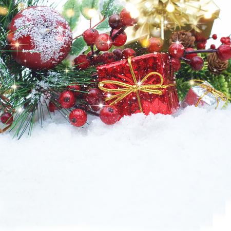 nestled: Christmas decorations nestled in snow Stock Photo