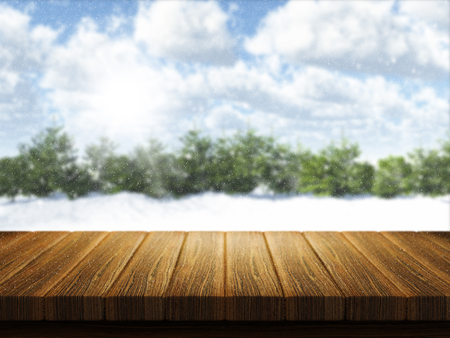 defocussed: 3D render of a wooden table with Christmas snowy landscape defocussed in the background Stock Photo
