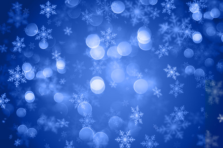 blizzards: Christmas background with a snowflake design and bokeh lights Stock Photo