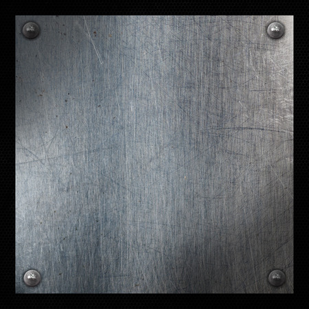 carbon fibre: Scratched metal plate on a grunge perforated background