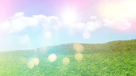 grassy: 3D landscape of grassy hill with clouds in a blue sky with retro effect