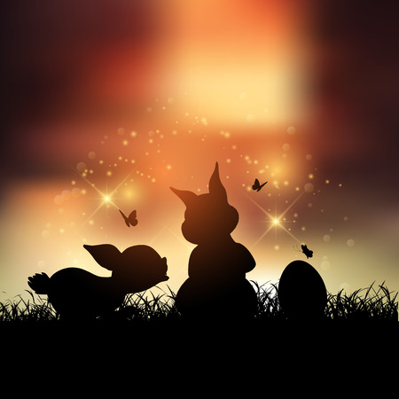 sunset sky: Silhouettes of Easter bunnies against a sunset sky