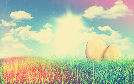 fluffy clouds: Retro image of a grassy landscape with golden Easter eggs against a blue sky with fluffy white clouds