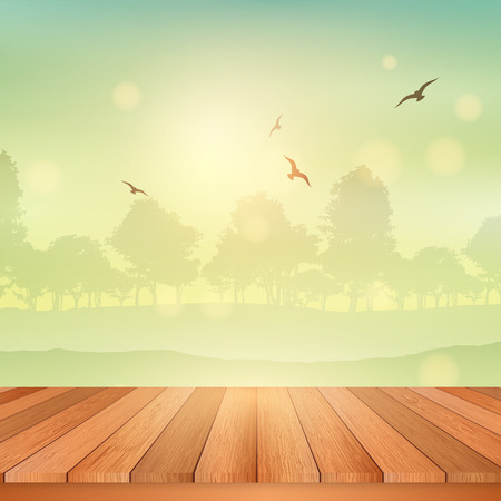 looking at view: Wooden table looking out to a view of a sunny landscape Stock Photo