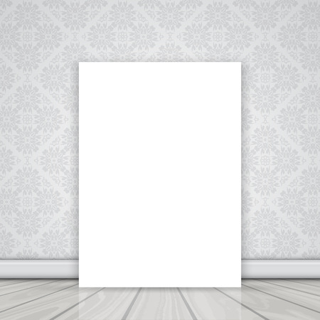 canvas: Blank canvas on the floor leaning against a wall with Damask wallpaper pattern Stock Photo