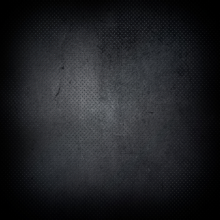 perforated: Dark grunge style perforated metal background
