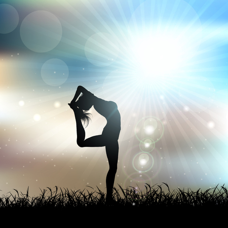 supple: Silhouette of a female in a yoga pose in a sunny landscape
