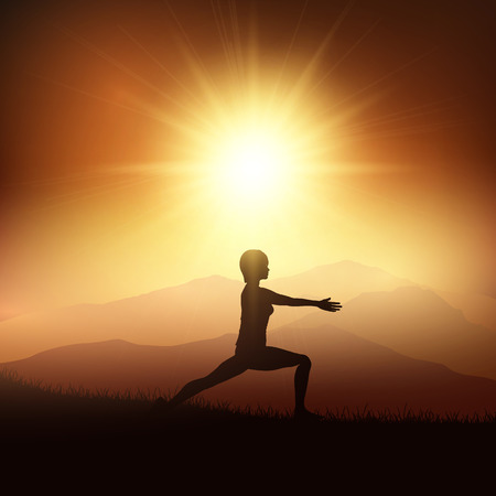 supple: Silhouette of a female in a yoga position against a sunset landscape Stock Photo