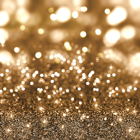 Gold Christmas glitter background with stars and bokeh lights