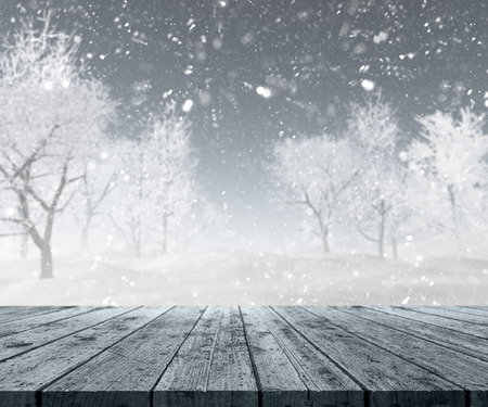 snow drifts: 3D render of a wooden table looking out to a winter landscape Stock Photo
