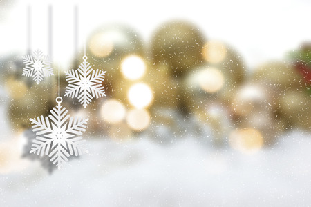 defocussed: Hanging Christmas snowflake decorations on a defocussed background Stock Photo