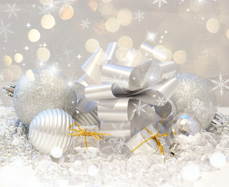nestled: Christmas background with gifts and baubles nestled in ice