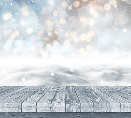 glittery: 3D render of a wooden deck looking out to a snowy landscape against a bokeh lights background Stock Photo