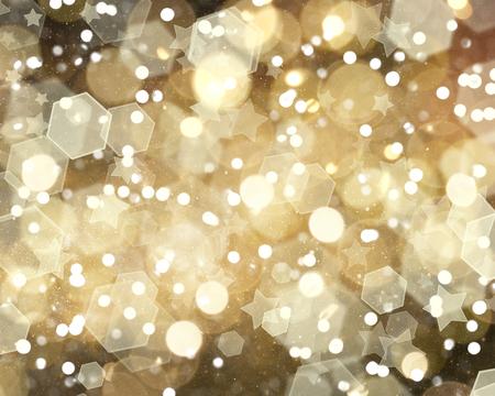 christmas lights background: Gold Christmas bokeh lights and stars background