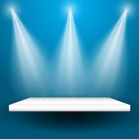 Spotlights shining down onto an empty display shelf