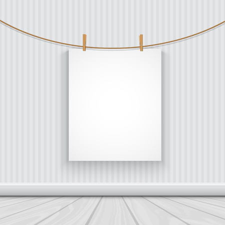 Blank picture hanging from a rope in a minimalist room