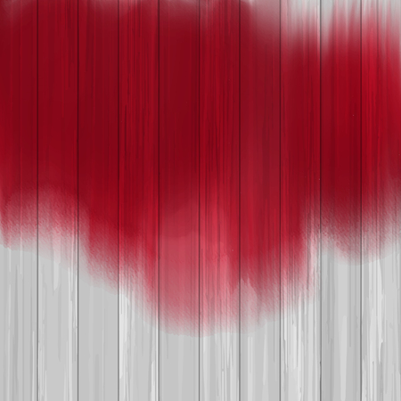 Red paint splatter on a wooden texture
