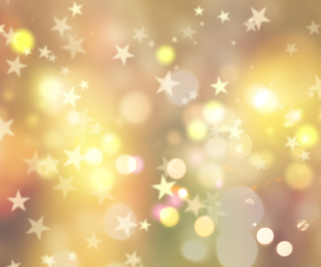 Decorative Christmas background of stars and bokeh lights Stock Photo