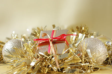 Christmas gift and decorations in gold tinsel