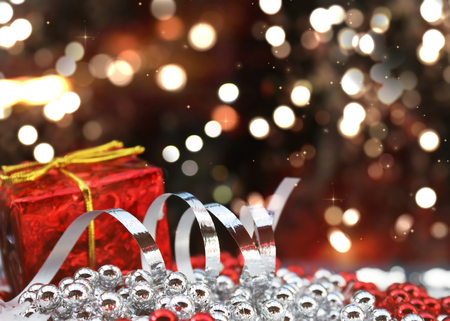 Christmas gift and decorations on defocussed bokeh lights background Stock Photo