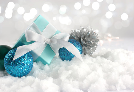 Christmas gift and decorations nestled in snow
