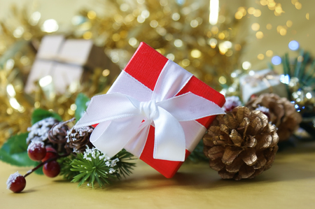 Luxurious red Christmas gift box on gold bokeh lights background