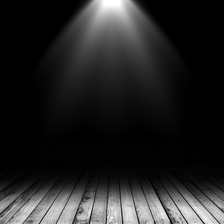 3D render of a spotlight shining down into a grunge interior with wooden floor