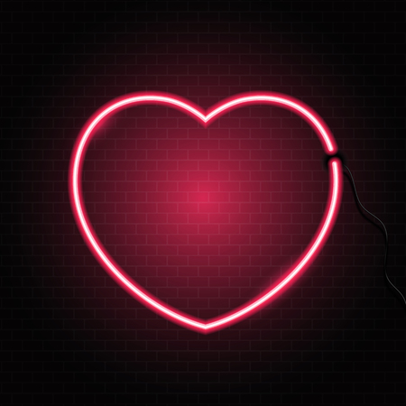 Glowing neon heart on a brick wall texture