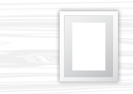 Empty picture frame on a white wooden texture background