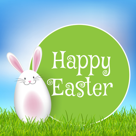 Easter background with cute bunny in grass and round sign Stock Photo