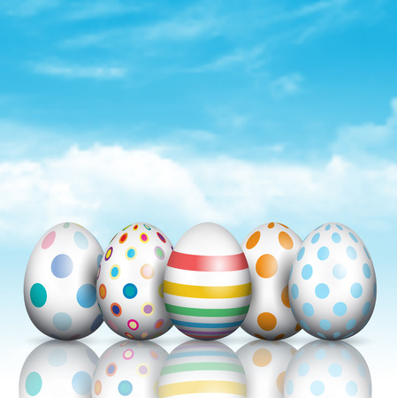 Colourful Easter eggs on a blue sky background Stock Photo