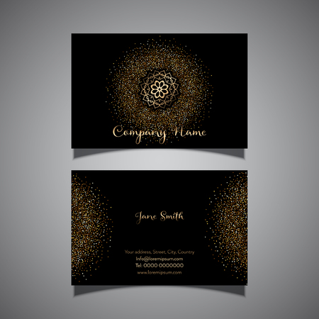 Business card with a gold glitter confetti design Stock Photo