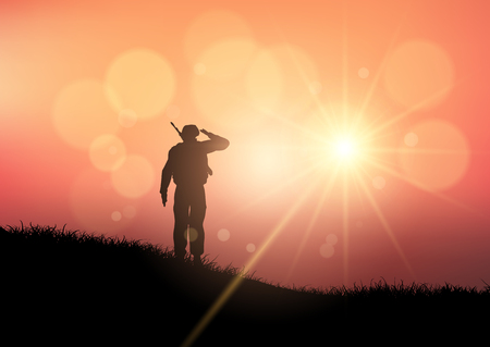 Silhouette of a soldier saluting at sunset Stock Photo