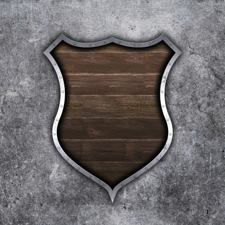 3D render of an old metal and wood shield on grunge concrete background