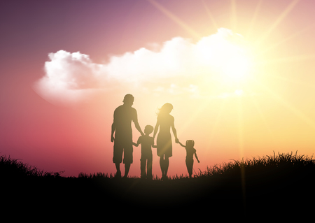 Silhouette of a family walking against a sunset sky Фото со стока