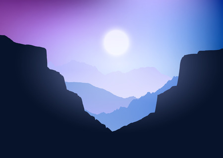 Silhouette of a canyon landscape against a sunset sky
